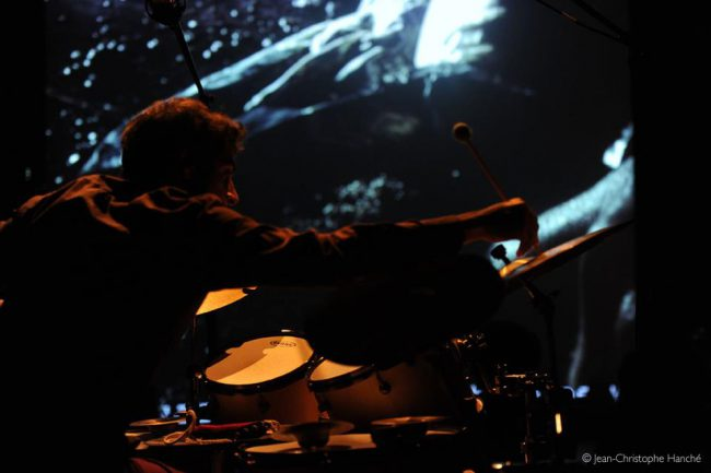 The artist on drums. Photo.