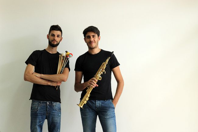 Two musicians with instruments . Photo