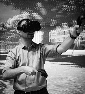 The researcher with oculus testing VR. Photo.