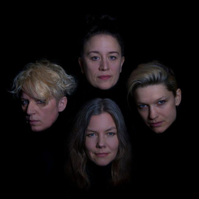 Portrait of Cecilia Nordlund and members from Fullmånen Från Helvetet. Photo.