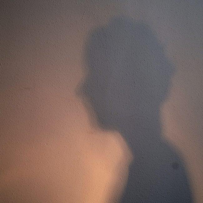 Shadow portrait on a wall. Photo.
