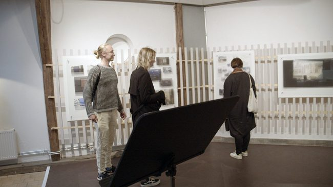Visitors looking at the installation. Photo.