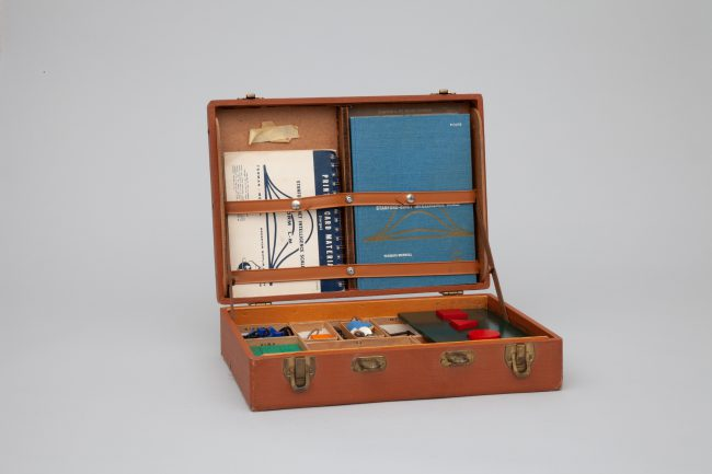 A small suitcase filled with various items. Photo.