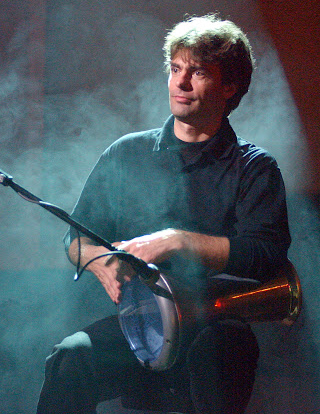 Portrait of the musician with drums. Photo.